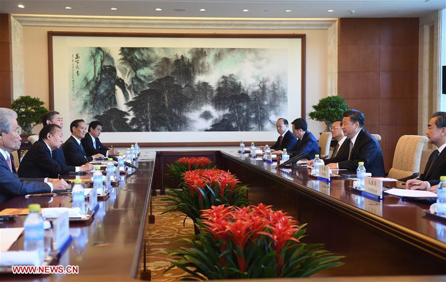 (XHDW)习近平会见日本自民党干事长二阶俊博
