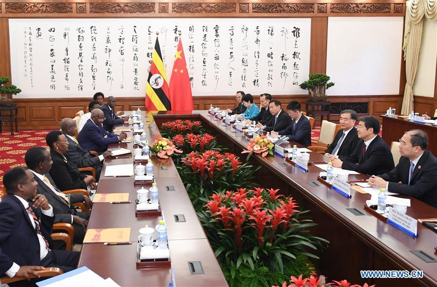 CHINA-BEIJING-WANG YANG-UGANDAN PRESIDENT-MEETING (CN)