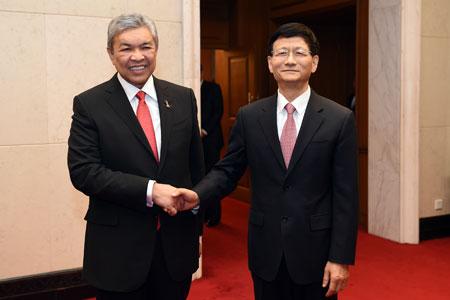 La Chine et la Malaisie s'engagent à renforcer leur coopération sur l'application  de la loi